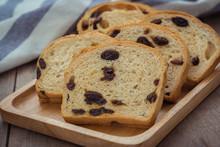 Sliced Raisin Bread On Wooden Plate