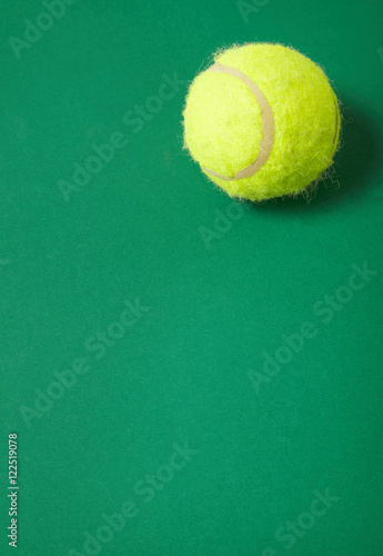 A Yellow Tennis Ball On A Green Background Forming A Sports Themed