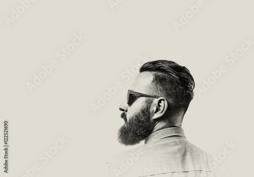 Fotografie, Obraz  Black and white portrait of a Bearded Man in a denim shirt and glasses  on toned background