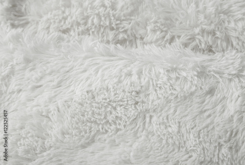 Photo  A full page of soft white faux fur fabric background texture