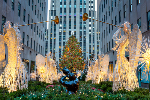 Foto auf Leinwand New York City Famous Christmas Decoration with Angels and Christmas Tree, NYC