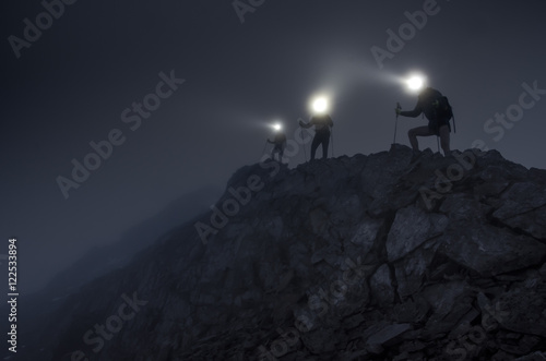 Obraz Lightbeams in the darkness on mountain ridge - fototapety do salonu