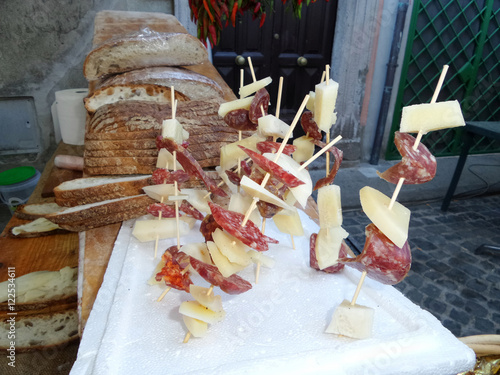 Fotografie, Obraz  Skewers with cheese, salami and Altamura bread typical from Puglia, Italy