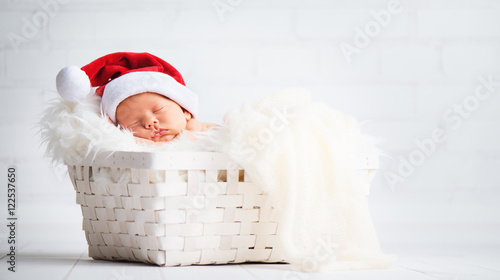 Photo  sleeper newborn baby in  Christmas Santa cap