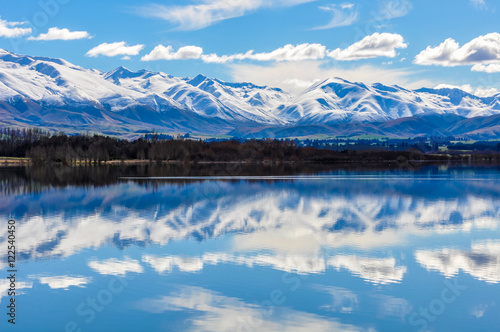 Fotobehang Bergen Reflection of snowy mountains near Fairlie, New Zealand