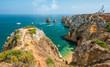 Scenic golden cliffs and emerald water in Ponta da Piedade, Lagos, Algarve, Portugal