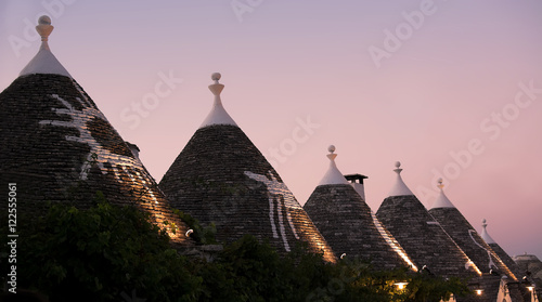 Photo Trulli at sunset in Alberobello (Italy)