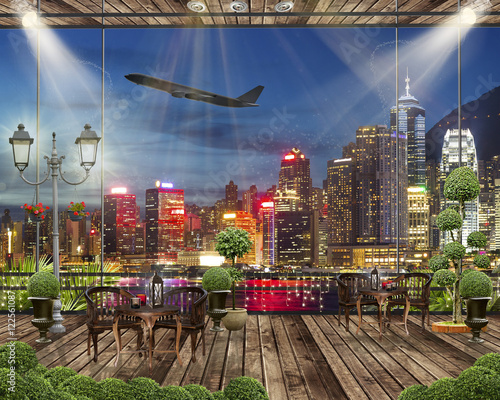 Poster Cappuccino Wood terrace with romantic lights, Night city view