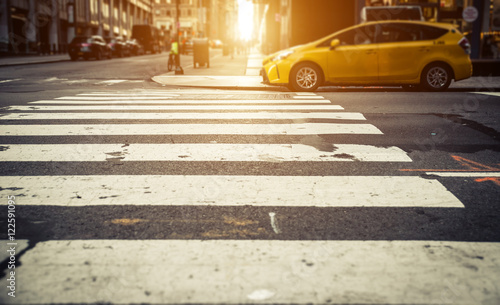 Poster New York TAXI Focus on pedestrian lines in New york, with yellow cab in the ba