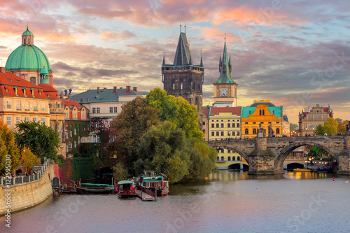 Staande foto Praag Famous Prague Landmarks - towers and bridge at sundown