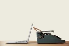 Old Typewriter And Laptop On T...