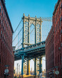 Manhattan bridge in old narrow Brooklyn street, New York City, U