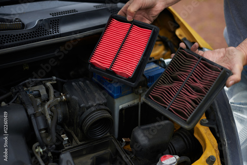 Photo  Comparison new and used air filter for car with engine bachground