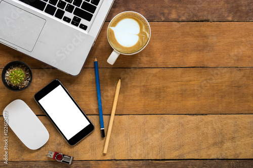 Fotografia, Obraz  Office desk table with blank screen smartphone, mouse, flashdrive, pencils, laptop and cup of coffee