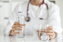 Woman Doctor With Drinking Water