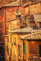FototapetaOld medieval houses in Siena, Tuscany province, Italy.