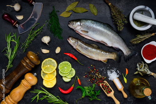 Trout Fish with Cooking ingredients on Dark Background Poster