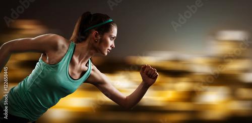 Women running at night in an urban setting