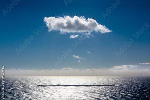 Seascape with single cloud