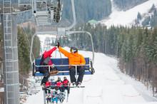 Two Male Ride The Ski Chair Li...