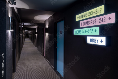 Illuminated wall signs hotel corridor