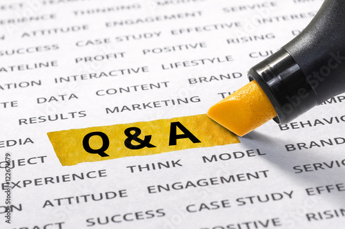 Photo  Q & A word highlighted with marker on paper of other related business word
