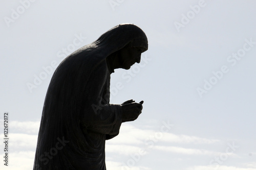 Fotografie, Obraz  Silhouete of a Statue of Mother Teresa in City of Struga, Ohrid Lake, Macedonia