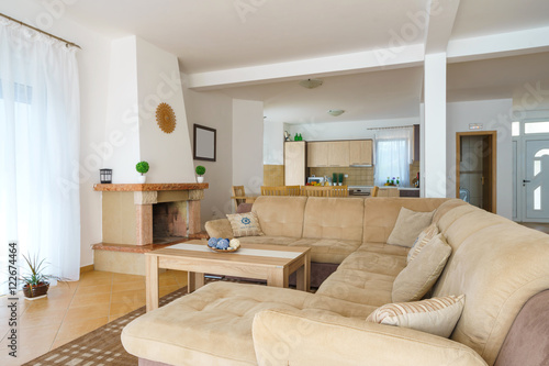 Fototapety, obrazy: Interior of a living room with kitchen zone in a villa