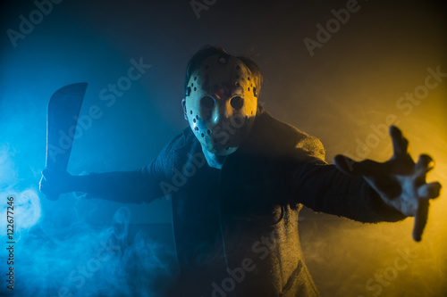 Photo  one caucasian man serial killer with mask portrait in silhouette studio, Scary h