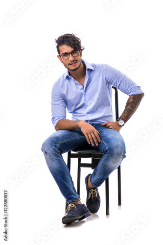 62f8f4c1760 Portrait of brunette young man in light blue shirt and jeans ...