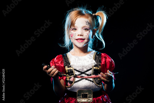little girl dressed as pirate - Buy this stock photo and explore