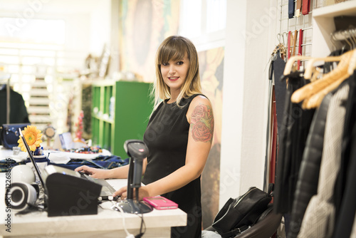 Fototapety, obrazy: Woman working in shopping store