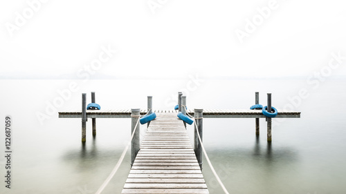 Fototapety, obrazy: Autumn. Wooden pier on the lake. Fog. Long exposure.