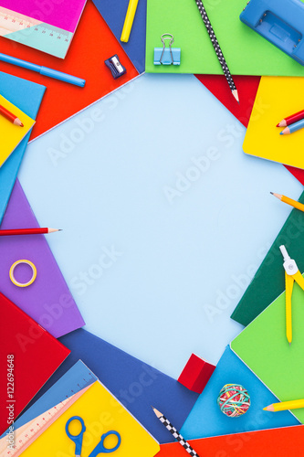 Photo Stands Back to school background with copy space. Variety of school supplies with copy space. Vertical.