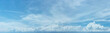 canvas print picture - Distant Line of Storm Clouds in a Sunny Sky