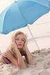 beautiful smiling girl taking sun on the beach