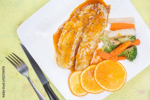 Dory fish steak with orange sauce Canvas Print