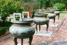 The Dynastic Urns Dedicated To Nine Emperors Of The Nguyen Dynasty In Front Of The Mieu, The Ancestor Worshiping Temple Inside The Imperial City Complex In Hue, Vietnam.