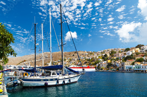 Spoed Foto op Canvas Stad aan het water Boats in the harbor of Symi Island. Greece, Europe