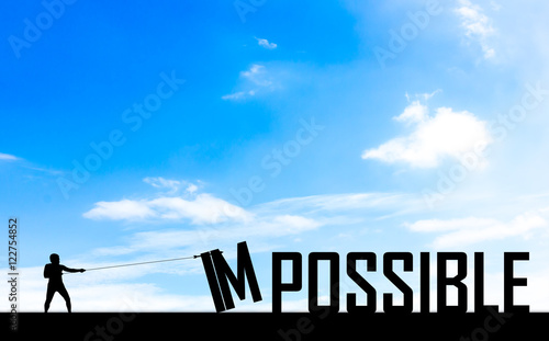 Fotografie, Obraz  Silhouette man or businessman eliminate, improve, change impossible to possible text with blue sky background  to success, challenge, motivation, achievement, goal improvement opportunity csr social