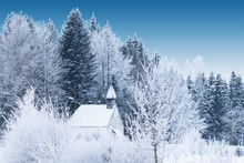 Snow-capped Little Wooden Chapel In Frosty Winter Forest
