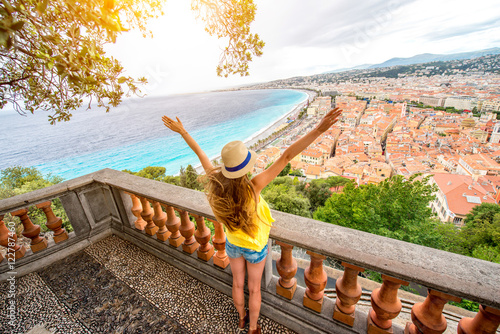 Poster Nice Young female traveler enjoying great view on the Nice city in France