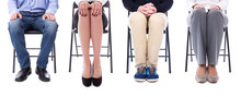 Career Concept - Legs Of Business People Sitting On Office Chair