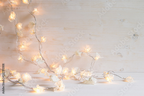 Christmas Lights Burning On A White Wooden Background Xmas