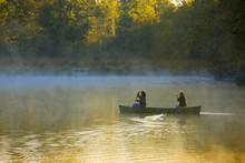 Canoeing Through Morning Mist