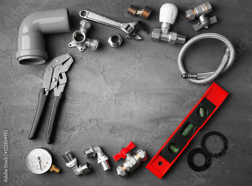 Foto op Aluminium Plumber tools frame on concrete structure background