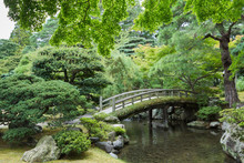 Kyoto, Japan - September 14, 2016: Part Of The Japanese Garden At The Imperial Palace Showing Bow Bridge, Pond, And Multiple Trees.
