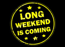 Long Weekend Is Coming Grunge Rubber Stamp On Black Background