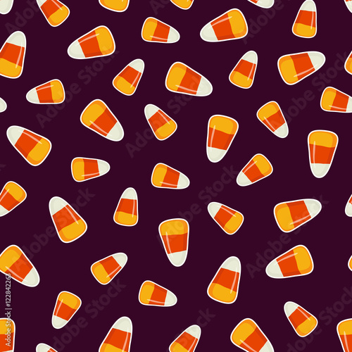 Printed kitchen splashbacks Draw Halloween pattern with small candy corns sweets on dark background. Holiday trick or treat concept.