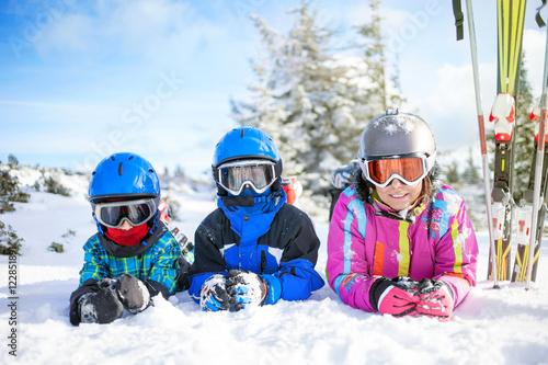 Fotobehang Wintersporten happy family ski team fun on beautiful mountain